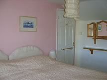 pink bedroom at the gables cottage